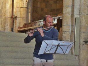 playing flute for guests